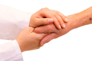 A doctor holding/ shaking an old womans hand.